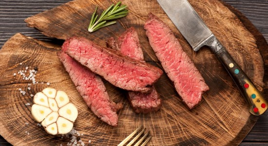 beef steakon wooden board