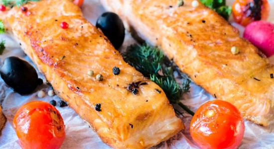 Juicy prepared salmon fillets and grilled tomato,selective focus