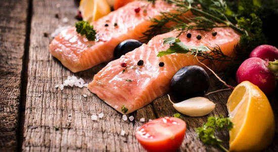 Raw salmons fillets on wooden background,selective focus