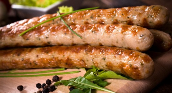 Close p to grilled sausages on wooden board,selective focus